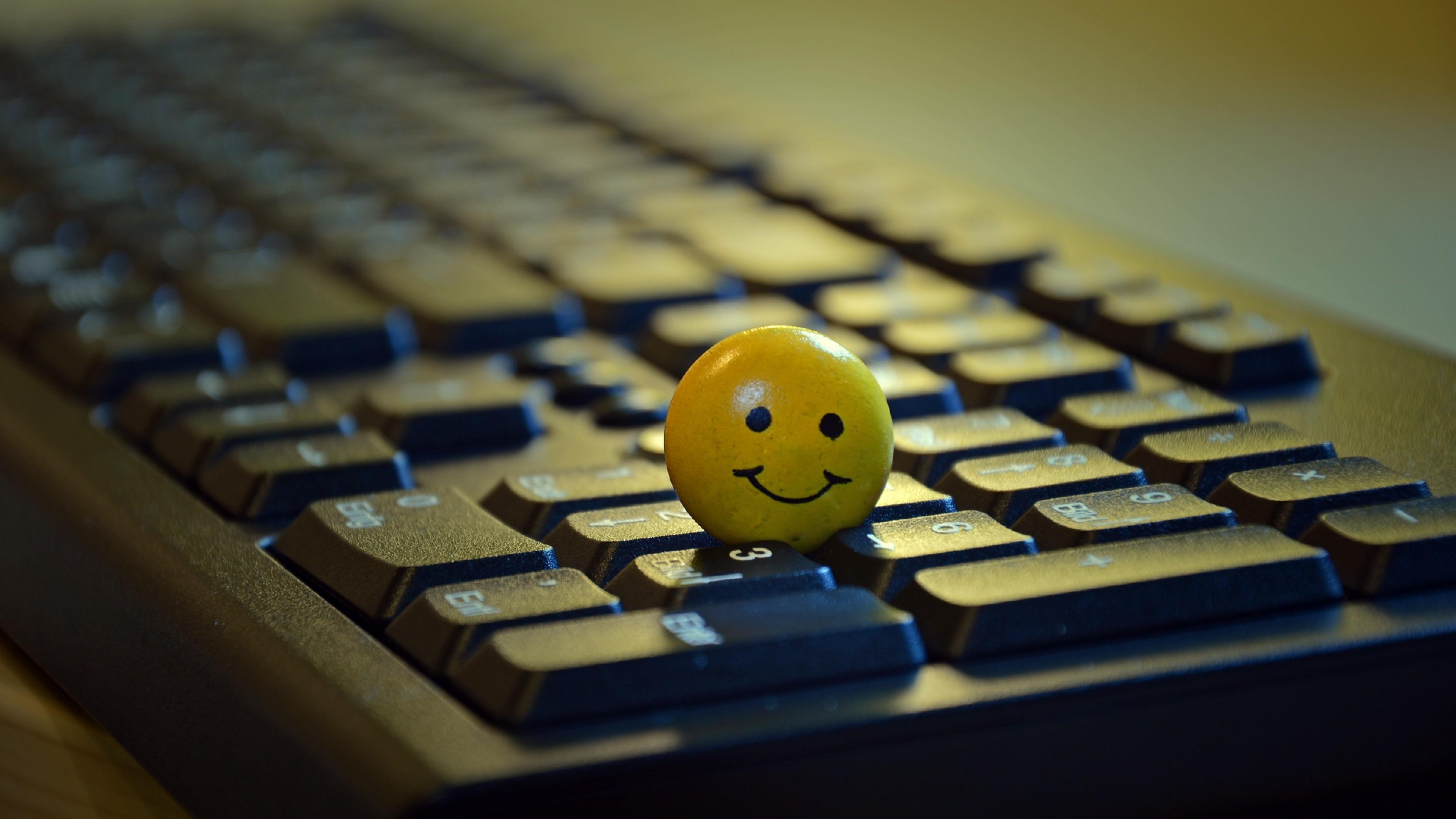 Smiley Standing On A Keyboard Hd Wallpaper 4k Ultra Hd Hd Wallpaper Wallpapers Net