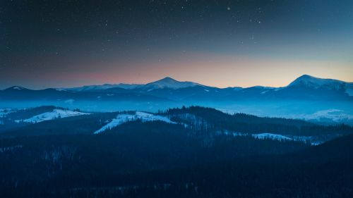Aerial view of mountains on a starry night HD Wallpaper