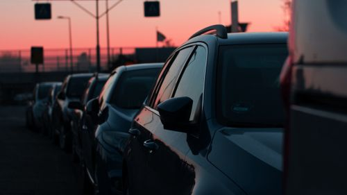 Car traffic during the sunset HD Wallpaper