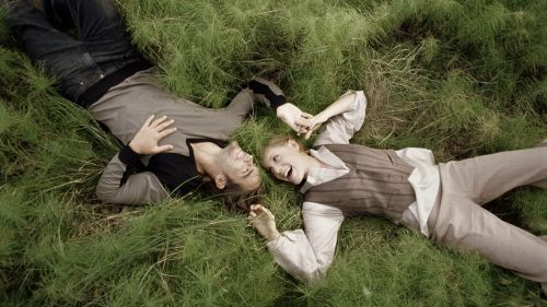 Couple laying at the grass HD Wallpaper