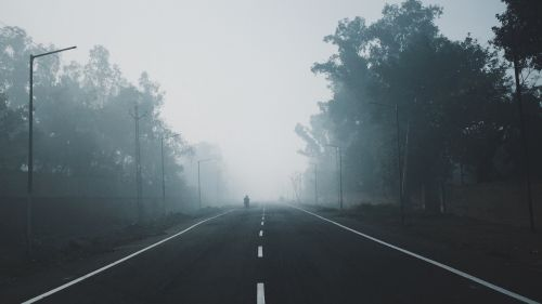 Driving on a foggy road HD Wallpaper