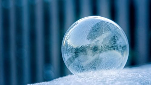 Glass Ball on White Surface HD Wallpaper