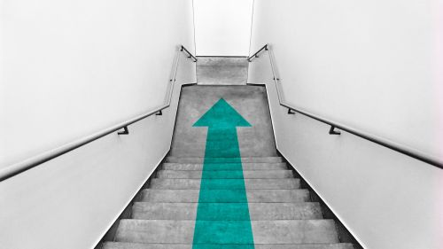 Green arrow at staircase HD Wallpaper