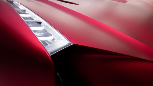 Headlights of red sports car HD Wallpaper