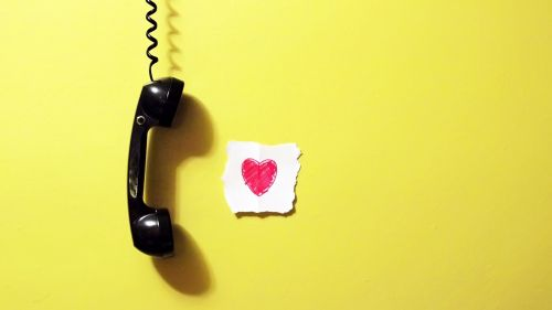 Heart next to the phone HD Wallpaper