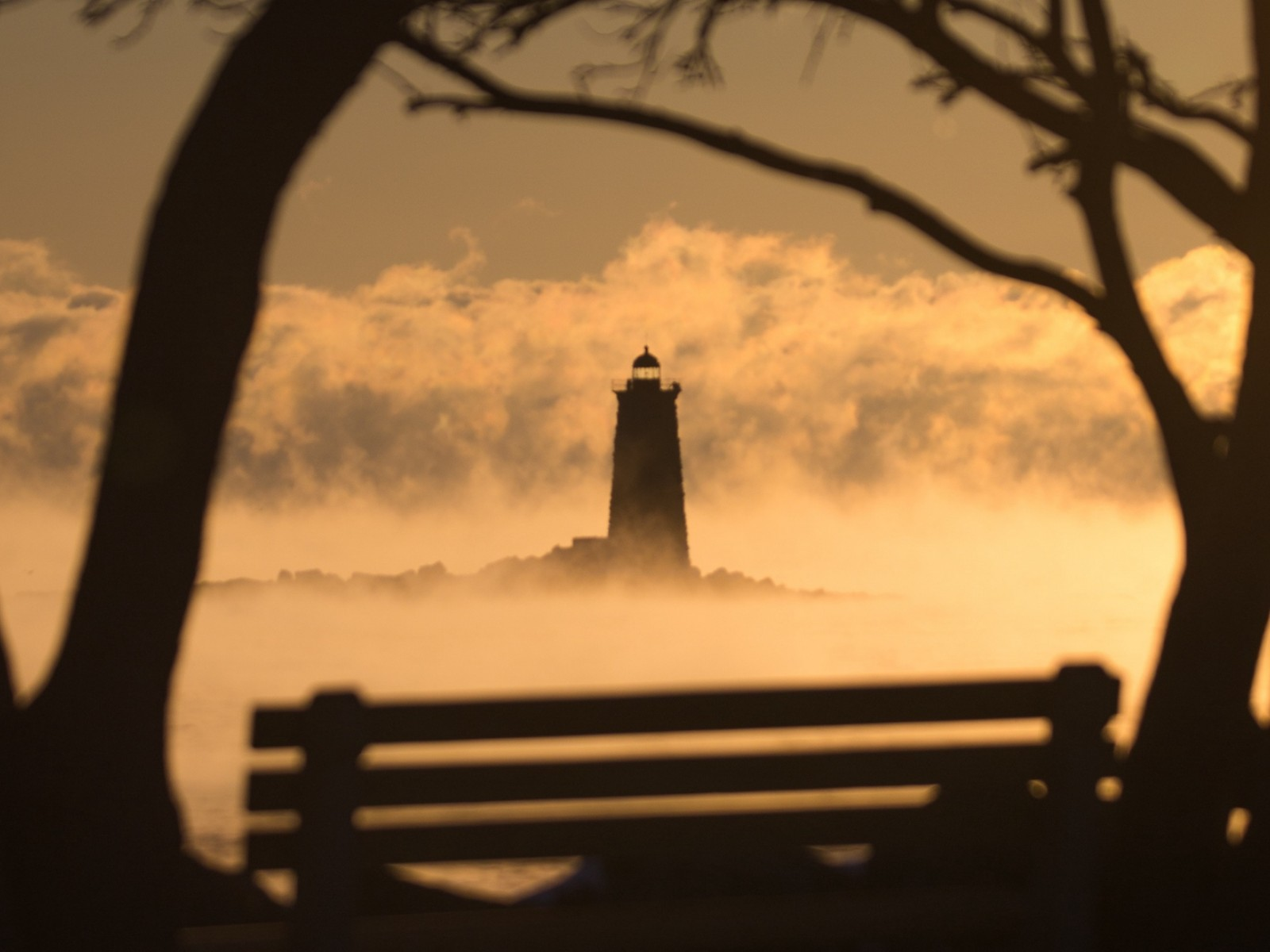 Lighthouse covered in fog HD Wallpaper