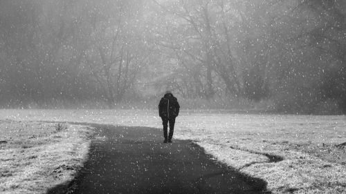 Lonely man walking on the road HD Wallpaper