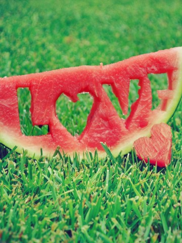 Love carved into a slice of watermelon HD Wallpaper