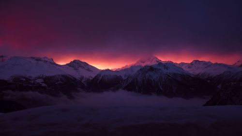 Mountains under a red sky HD Wallpaper