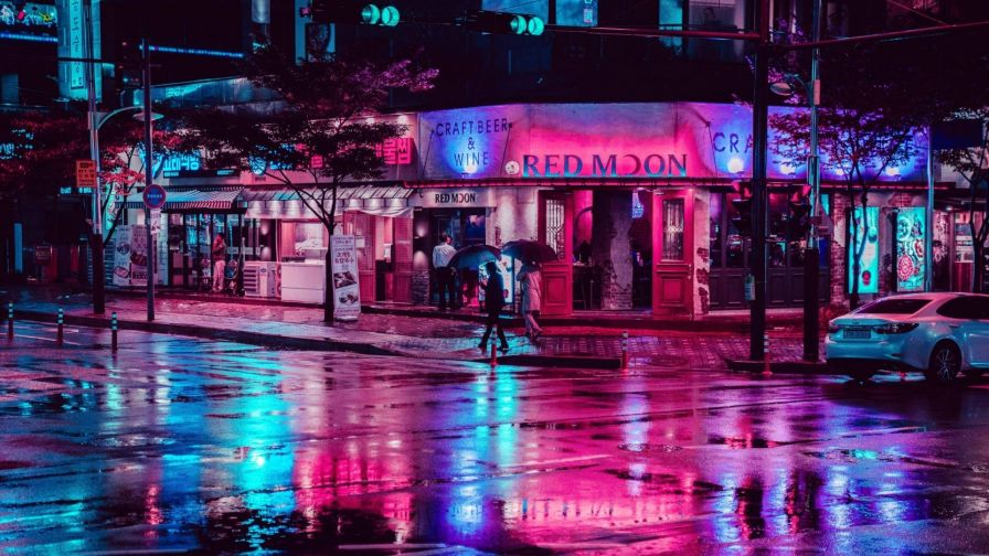 Reflection of neon lights at street HD Wallpaper