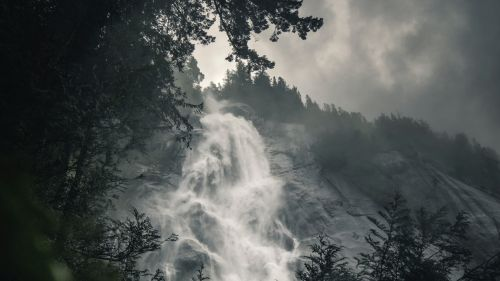 Waterfall covered in fog HD Wallpaper