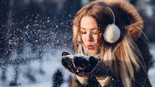 Woman Blowing Snow from Hand HD Wallpaper