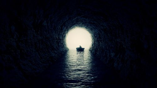Boat inside the cave HD Wallpaper