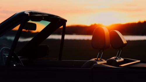 Sunset view from inside of a convertible HD Wallpaper